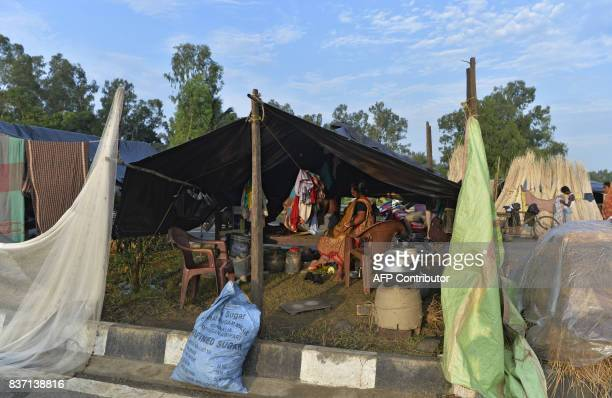 Indian flood effected villagers cooks food in temporary shelters along National Highway 34 as their houses were submerged by flood waters in Gazole...