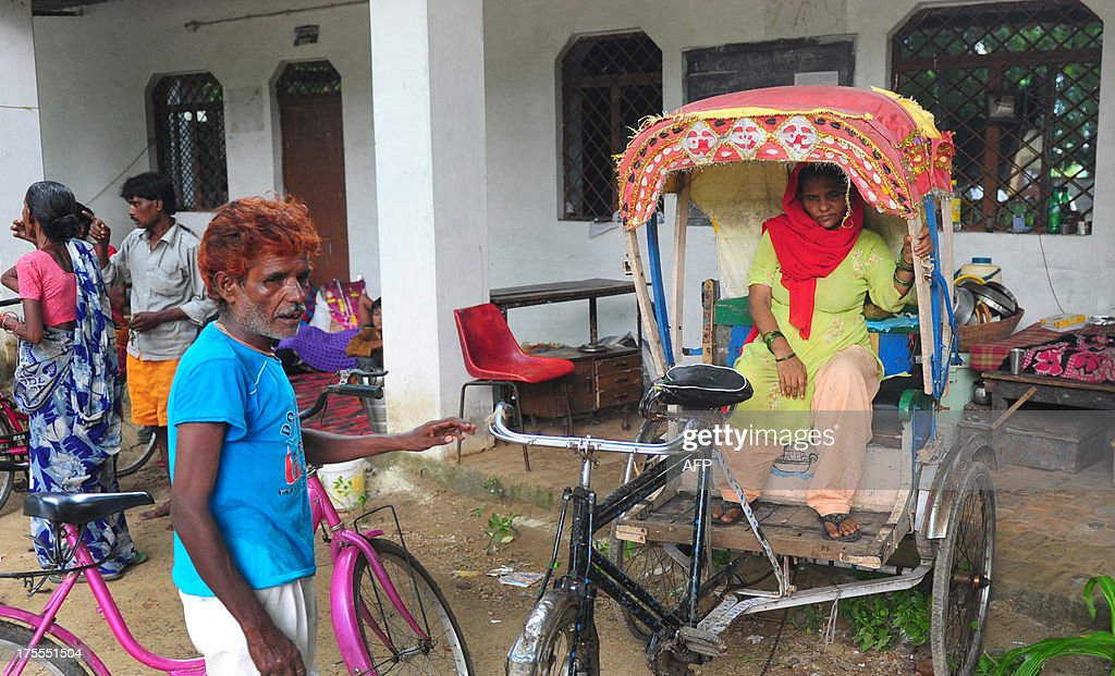 Indian flood-affected villagers from Newada Village rest at a local shelter in Allahabad on August 4, 2013. The monsoon, which covers the subcontinent from June to September and usually brings flooding, accounts for about 80 percent of India's annual rainfall. AFP PHOTO/ SANJAY KANOJIA