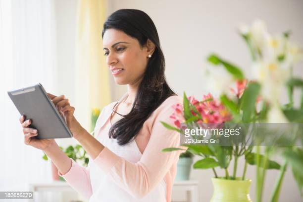 Indian florist using tablet computer