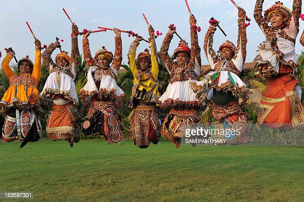 Indian folk dancers from the Panghat Group of Performing Arts participate in a full dress rehearsal for the forthcoming Navratri festivities or Dance...