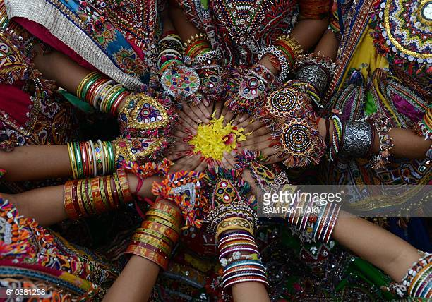 TOPSHOT Indian folk dancers from the Panghat Group of Performing Arts pose for a photograph during a dress rehearsal for an event to mark the...