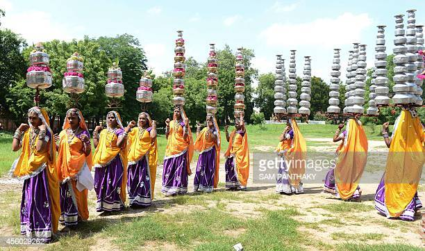 Indian folkdancers of Ambawadi Kala Vrund from Jamkhambhaliya town rehearse the traditional dance 'Bavan Beda No Raas' carrying 52 utensils prior to...