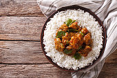 Indian food: Madras beef with basmati rice on the table. horizontal view from above