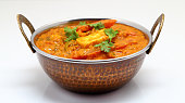 Indian Food or Indian Curry in a copper brass serving bowl.Indian Food or Indian Curry in a copper brass serving bowl.