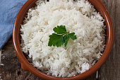basmati rice boiled served on pot with parsely