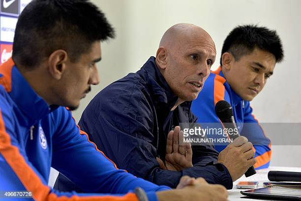 Indian football coach Stephen Constantine addresses a press conference by the Indian football team as footballers Sunil Chhetri and Gurpreet Singh...