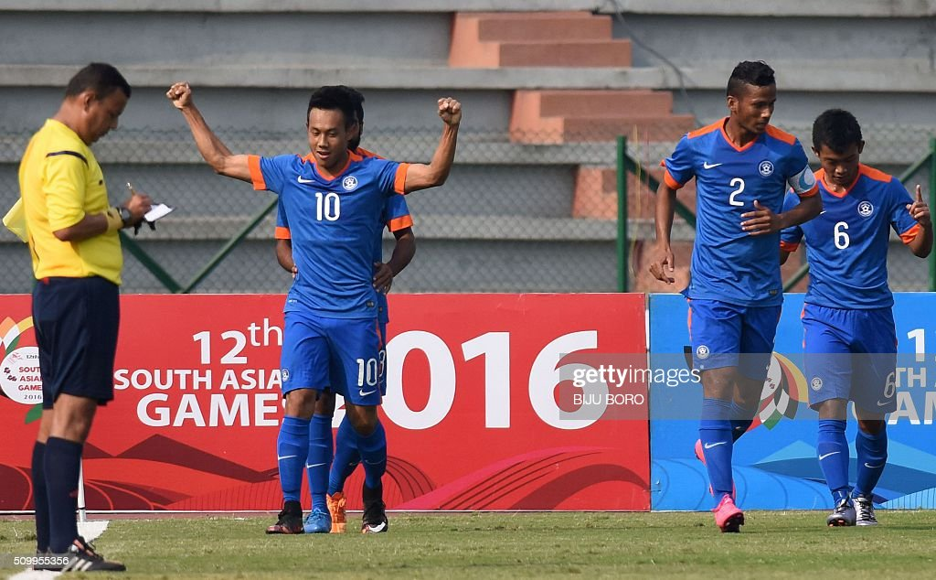 Indian football player Kumam Udanta Singh (L) celebrates after scoring a goal in the semi-final match against Bangladesh during the 12th South Asian Games 2016 in Guwahati on February 13, 2016. India beat Bangladesh 3-0. AFP PHOTO / Biju BORO / AFP / BIJU BORO