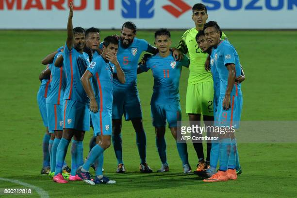 Indian football team captain Sunil Chhetri and teammates celebrate their team's 41 victory during the 2019 AFCAsian Cup qualifying match between...