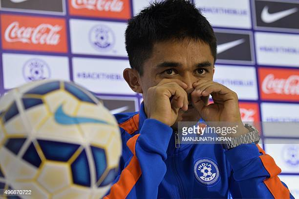 Indian footballer Sunil Chhetri gestures during a press conference by the Indian football team in Bangalore on November 11 2015 India play Guam in...