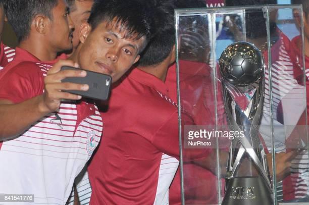 Indian Footballers his mobile Selfie at The FIFA U17 World Cup 2017 Winners Trophy visit in Kolkata City on September 012017 at Kolkata Khudiram...
