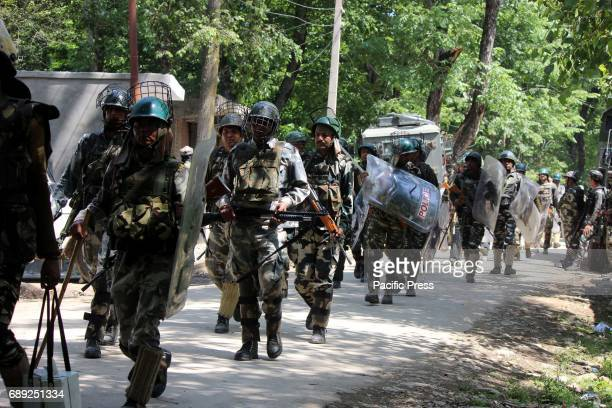 Indian forces after two Hizbul Mujahideen rebels were killed in a 16 hour long gun battle with government forces Subzar Ahmed aged 30 and a teenage...
