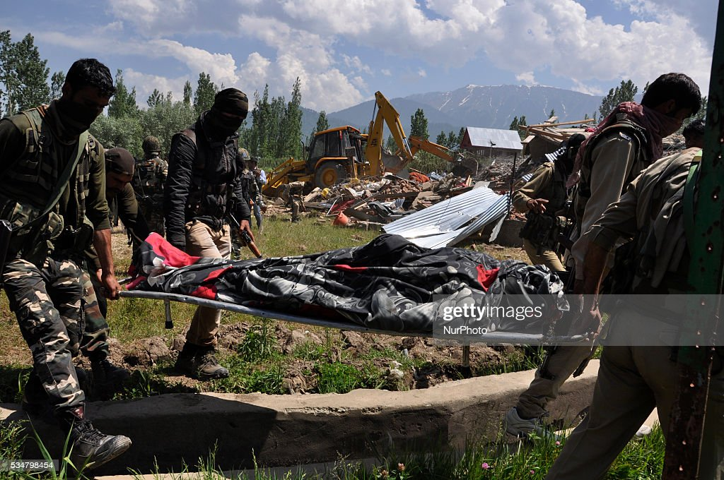 Indian forces carry body of a rebel recovered from the debris of the residential house site in Khonshipora 25 miles west of srinagar on May 27,2016.Two rebels were killed by indian forces during a brief gunfight.