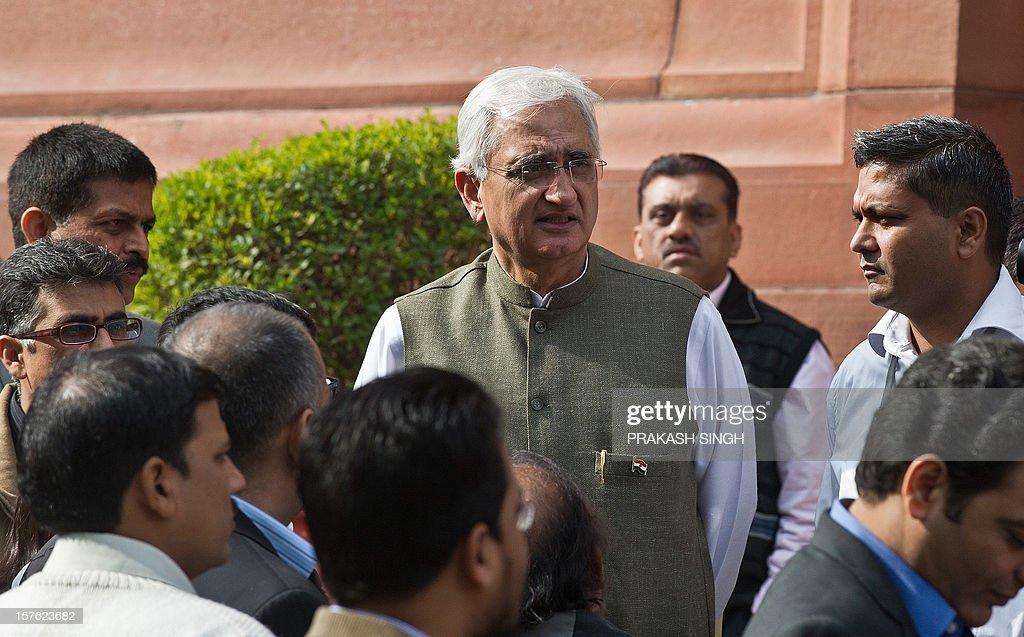 Indian Foreign Minister Salman Khurshid (C) interacts with the media at Parliament house during the winter session in New Delhi on December 5, 2012. India's government, which lost its majority in September, faced a test of its ability to marshal support in parliament on Wednesday with a vote on a contentious recent reform of the retail sector. After two days of stormy debating in the rowdy lower house, lawmakers are set to pass judgement on new rules opening up the highly protected retail sector to foreign supermarkets that are being allowed in for the first time. AFP PHOTO/ Prakash SINGH