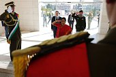 Indian Foreign Minister Sushma Swaraj stands after laying a wreath at the tomb of the late Palestinian leader Yasser Arafat at the Muqataa the...