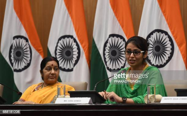 Indian Foreign Minister Sushma Swaraj watches Indian national Uzma Ahmed address a press conference upon her return from Pakistan at the Foreign...