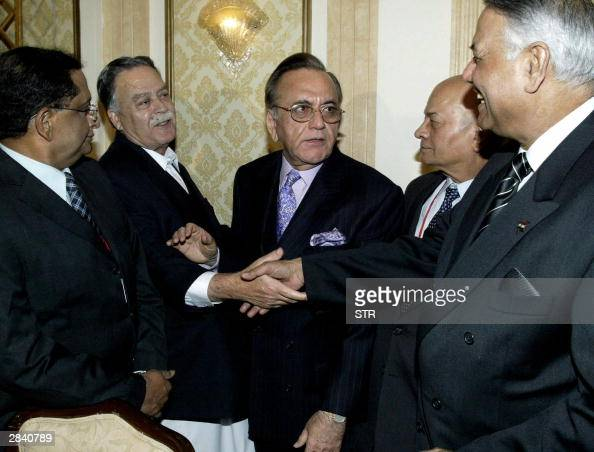 Indian Foreign Minister Yashwant Sinha shakes hands with Pakistanicontrolled Kashmir Prime Minister Sardar Sikandar Hayat while Pakistani Foreign...