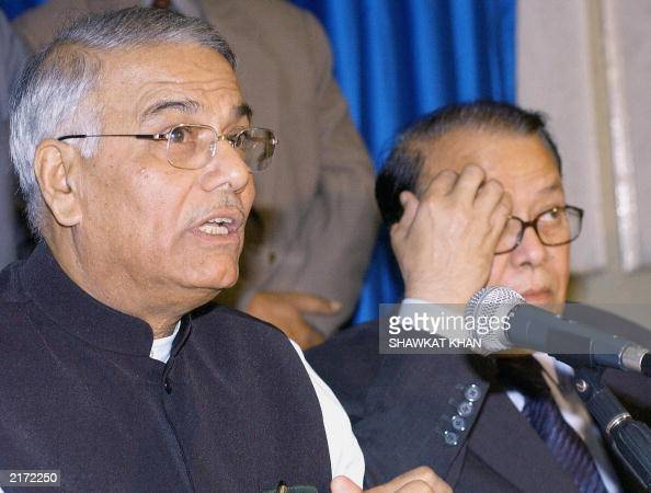 Indian Foreign Minister Yashwant Sinha speaks during a press conference as his Bangladeshi counterpart Morshed Khan listens in Dhaka 16 July 2003 The...