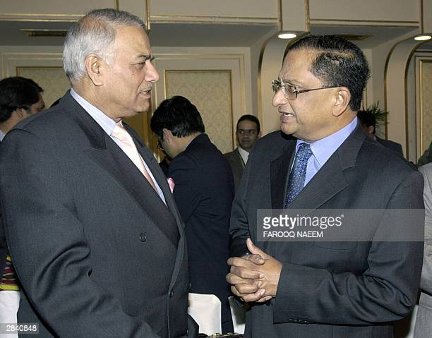 Indian Foreign Minister Yashwant Sinha talks with his Sri Lankan counterpart Tyronne Fernando before the start of a two day meeting of the council of...