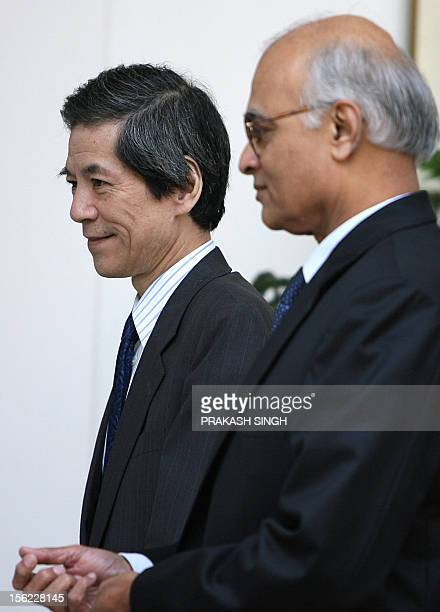 Indian Foreign Secretary Shiv Shankar Menon and Japan's Deputy Foreign Minister Tsuneo Nishida walk back after a meeting in New Delhi 13 November...