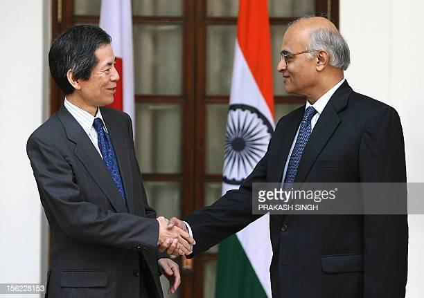Indian Foreign Secretary Shiv Shankar Menon and Japan's Deputy Foreign Minister Tsuneo Nishida shake hands after a meeting in New Delhi 13 November...