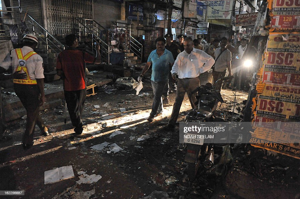 Indian forensics officials are pictured at the site of a bomb blast at Dilshuk Nagar in Hyderabad on February 21, 2013. At least 18 people were killed and 52 wounded when bombs ripped through crowded areas of the Indian city of Hyderabad on Thursday in what the prime minister called a 'dastardly act'. AFP PHOTO / Noah SEELAM