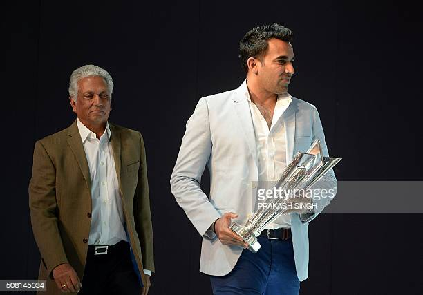 Indian former cricketers Mohinder Amarnath and Zaheer Khan arrive with the ICC T20 world cup trophy at the Indian Auto Expo 2016 in Greater Noida on...