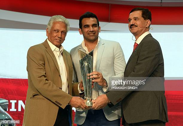 Indian former cricketers Mohinder Amarnath Zaheer Khan and managing director for Nissan Motors India Arun Malhotra pose with ICC T20 world cup trophy...