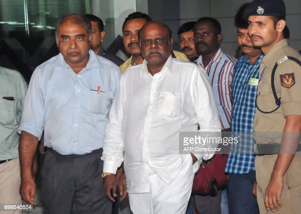 Indian former judge Chinnaswamy Swaminathan Karnan is escorted by police personnel as he arrives at the airport in Kolkata on June 21 2017 Karnan who...