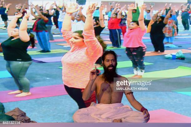 Indian founder of the Akshar Power Yoga Foundation Master Akshar speaks to participants as they take part in a yoga and selfdefence lesson for women...