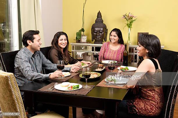 Indian Friends Eating Meal Together