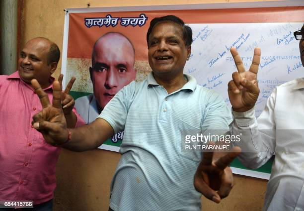 Indian friends of Kulbhushan Jadhav pose for media in the neighborhood where he grew up in Mumbai on May 18 2017 The UN's top court on May 18 ordered...