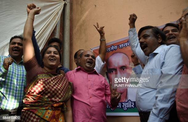 Indian friends of Kulbhushan Jadhav react after he was given a stay of execution in the neighborhood where he grew up in Mumbai on May 18 2017 The...