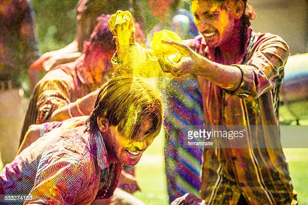 Indian friends throwing Holi Colorful Powder at each other