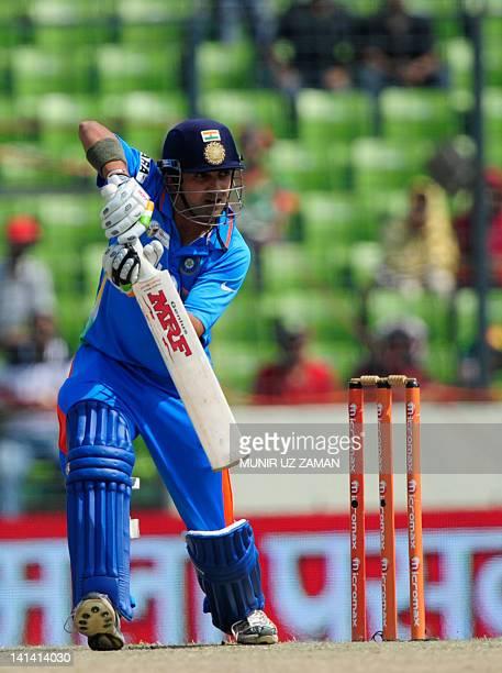 Indian Gautam Gambhir plays a shot during the one day international Asia Cup cricket match between India and Bangladesh at The ShereBangla National...