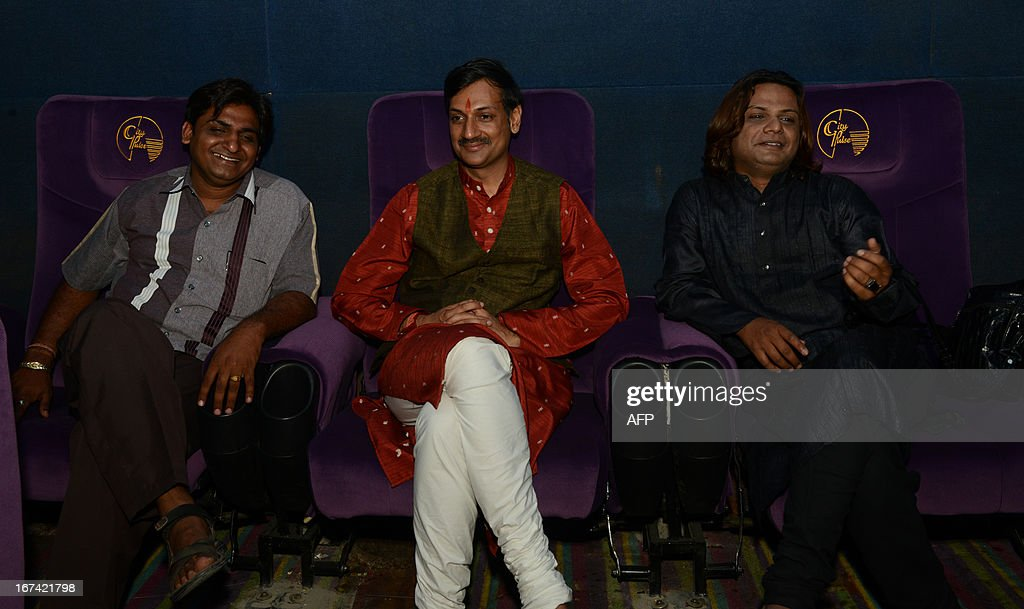 Indian gay activists, Prince of Rajpipla Manvendra Singh Gohil (C), and Silvester Merchant (R) watch a film on homosexuality 'Meghdhanushya - Colour Of Life' during its premiere in Gandhinagar, some 30 kms. from Ahmedabad on April 25, 2013. Both Manvendra and Silvester acted in 'Meghdhanushya - The Colour Of Life' the first film in Gujarati language about the gay community and the problems faced by them in society. AFP PHOTO / Sam PANTHAKY