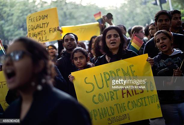 Indian gayrights activists take part in a protest against the Supreme Court ruling reinstating a ban on gay sex in New Delhi on December 11 2013...
