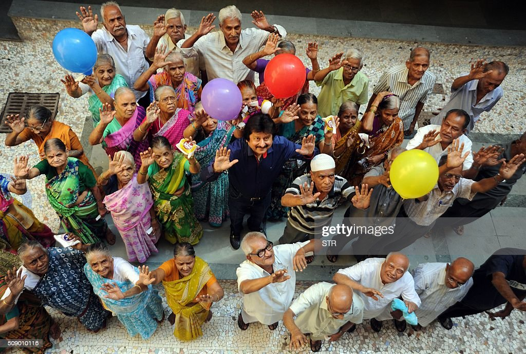 Indian Ghazal maestro Pankaj Udhas (C) visits an old people's home for a concert to mark his 35 years in show business in Mumbai on February 8, 2016. AFP PHOTO / AFP / STR