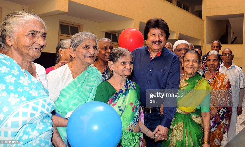 Indian Ghazal maestro Pankaj Udhas (centre R) visits an old people's home for a concert to mark his 35 years in show business in Mumbai on February 8, 2016. AFP PHOTO / AFP / STR