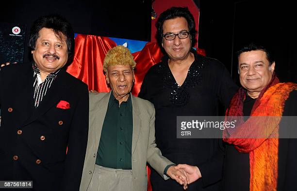 Indian Ghazal singer Pankaj Udhas music director and composer Khayyam Talat Aziz and Bhajan and Ghazal singer Anoop Jalota pose as they attend the...