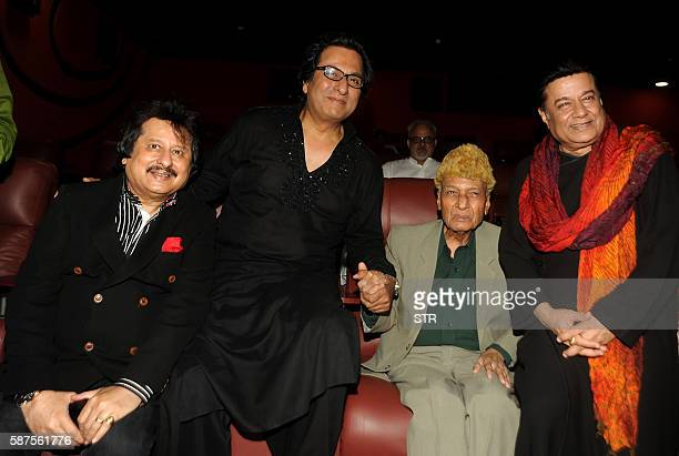 Indian Ghazal singer Pankaj Udhas Talat Aziz music director and composer Khayyam and Bhajan and Ghazal singer Anoop Jalota pose as they attend the...