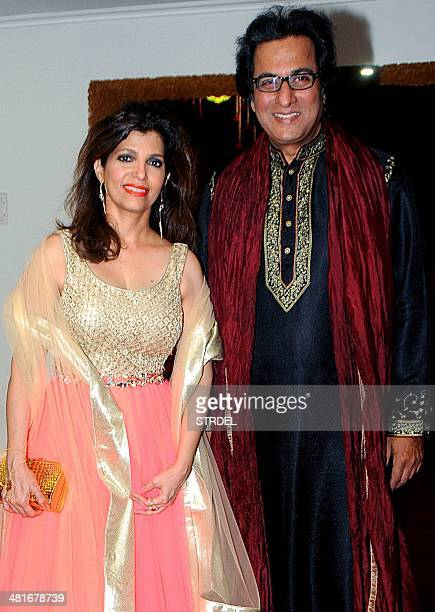 Indian ghazal singer Talat Aziz and his wife Bina Aziz pose for a photograph during a 'Shaam eQwwali' event in Mumbai on late March 30 2014 AFP PHOTO...