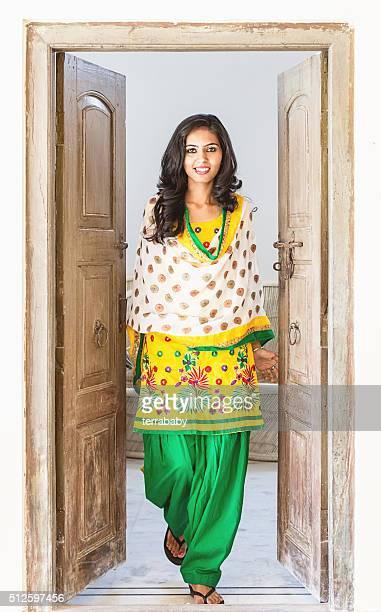 Indian Girl opening the Door