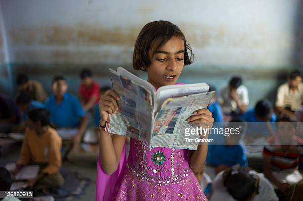 Indian girl reading aloud during English lesson at Rajyakaiya School in Narlai village Rajasthan Northern India