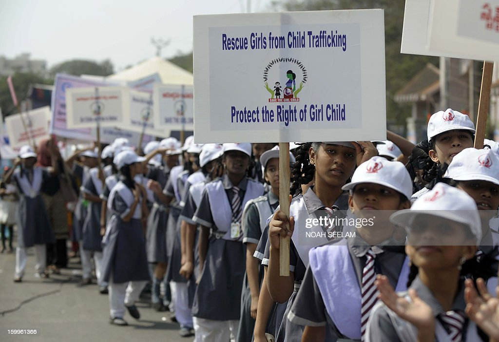 Indian girl students hold placards during a rally on the occassion of National Girl Child Day in Hyderabad on January 24, 2013. The Government of India in 2008 declared January 24 of every year to be celebrated as the 'National Girl Child Day' with the objective of raising consciousness of the society towards the girl child so that she can be valued and respected. AFP PHOTO / Noah SEELAM