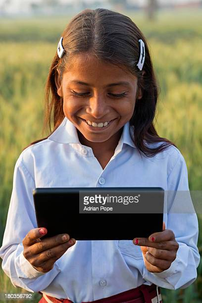 Indian girl using  tablet device