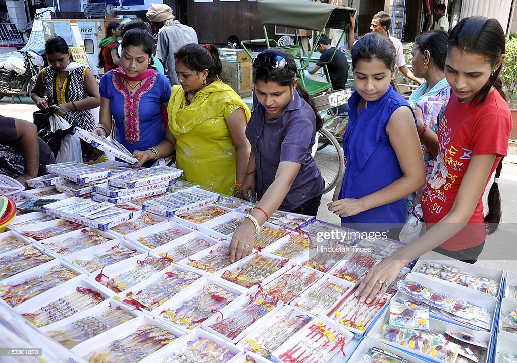 Indian girls buy Rakhis ahead of Raksha Bandhan on August 7, 2014 in Ghaziabad, India. The festival of Raksha Bandhan' or 'Rakhi' celebrate the brother-sister love. Sisters tie sacred Rakhi string on their brothers' right wrists and pray for their protection.
