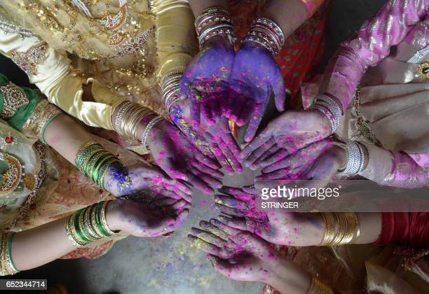 Indian girls celebrates Holi the Festival of Colours in Dharmanagar in the north eastern state of Tripura on March 12 2017 The popular Hindu spring...