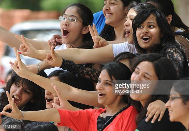 Indian girls flash the victory sign after checking their high school exam results in New Delhi on May 23 2011 Girls outshone boys in the Central...