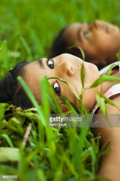 Indian girls laying in grass