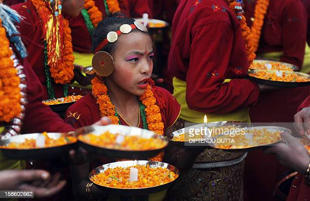 Indian girls of Nepali origin perform during the inauguration of the Darjeeling Tea and Tourism Festival in the northern hill town of Darjeeling on...